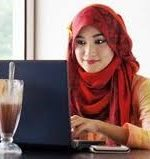 Indonesian woman at a computer